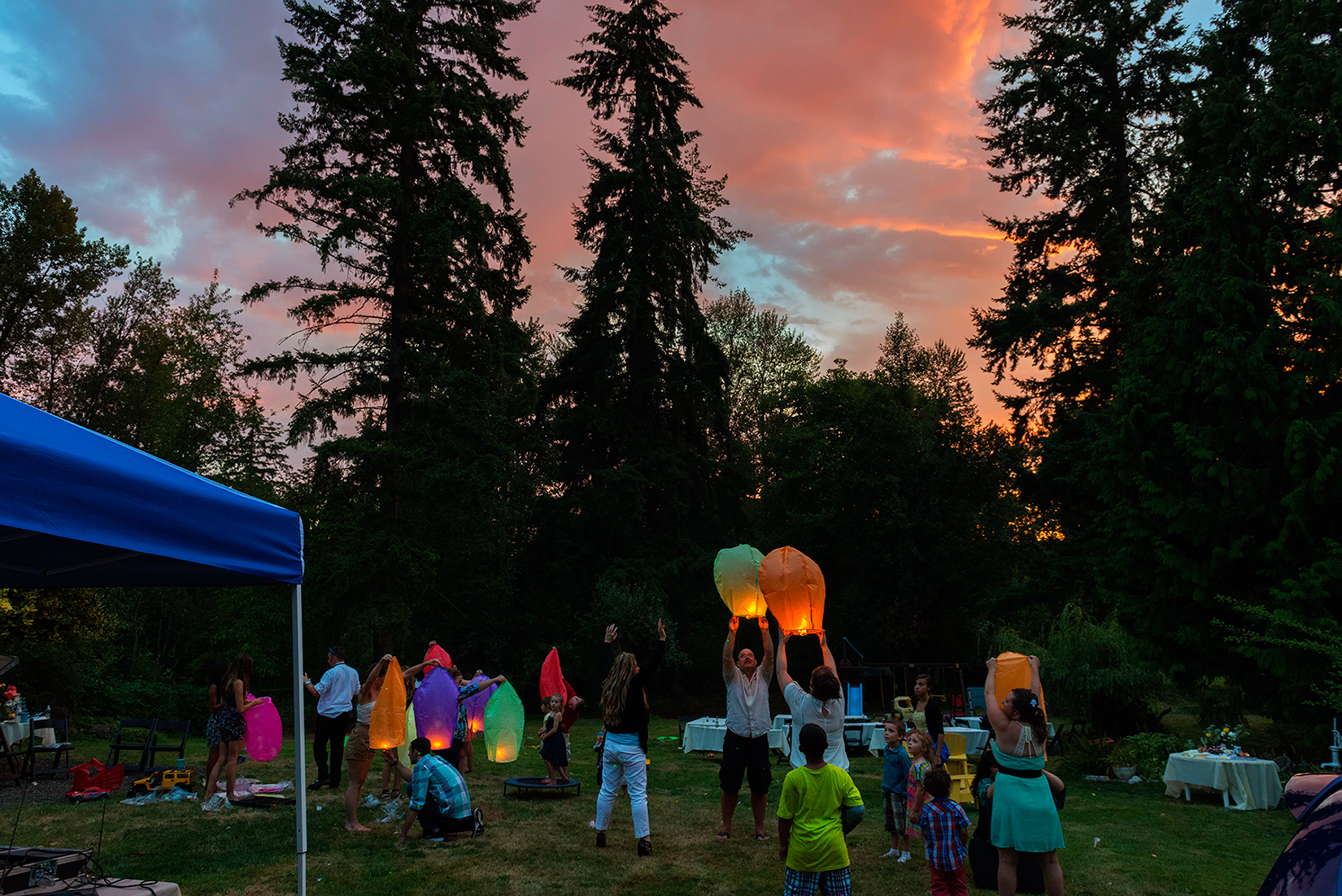 Wishing lanterns released backyard party
